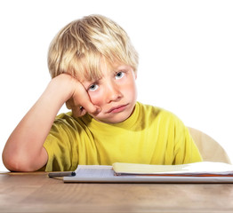 desperate boy doing his homework - isolated on white background