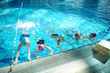 happy childrens at swimming pool