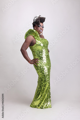 Drag queen wearing a green gown with sequins.