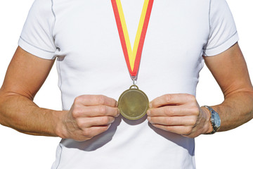 man holding medal before breast
