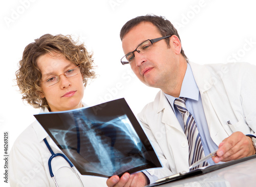 Two doctors looking an x-ray image