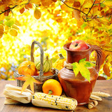 Autumn vegetables on golden forest background