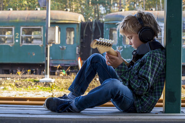 boy with headphone and guitar