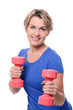 Cute mid aged women do exercises with dumbbells