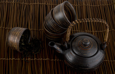 tea set with green tea on a dark background