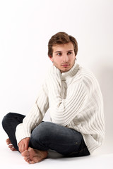 Portrait of Beautiful and attractive man sittig in sweater