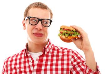 Funny man in glasses eating hamburger