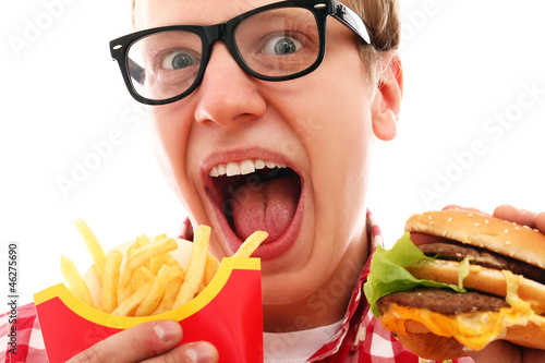 Funny man in glasses with french fries and hamburger