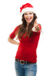 Woman in Santa hat gives thumbs up.