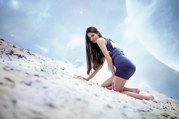 Sexual woman in dress on the cosmic beach