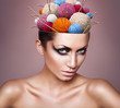 woman with ball of threads in head and knitting needls