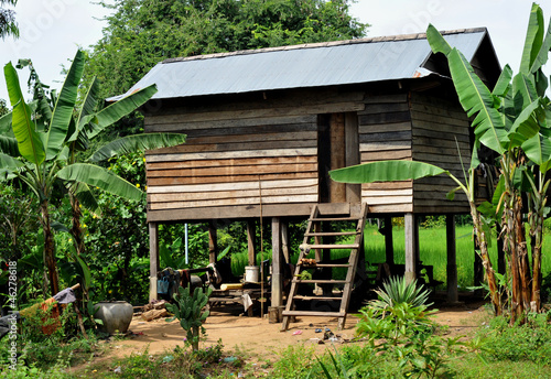 Leinwandbild Motiv village house on stilts in cambodia