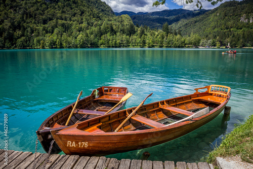 Boats at the pier of the Bled Island, Lake Bled, Slovenia.