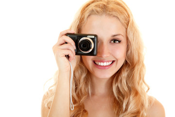 Happy young woman doing photos with still camera