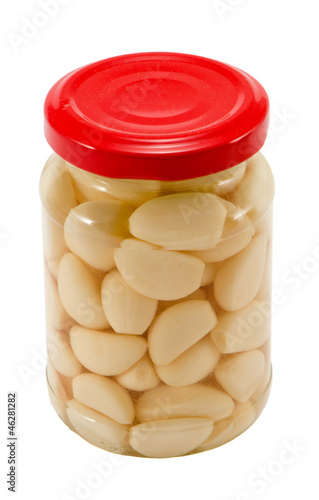 Glass jar pot of preserved garlic isolated