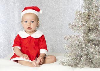 Christmas baby - Baby mit Weihnachtsmannkostüm