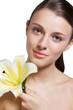 Beautiful model studio holding yellow flower