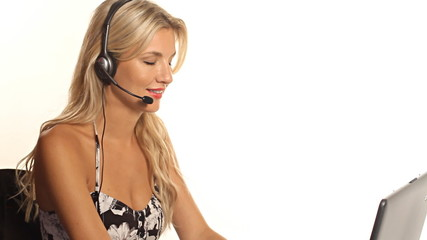 Blond customer service woman talking on headset