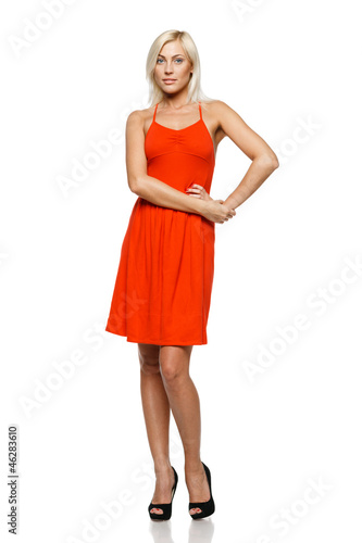 Full length of young woman standing with her hand on hip
