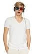 Surprised man in three-dimensional glasses and headphones