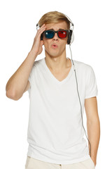 Disappointed man in three-dimensional glasses and headphones