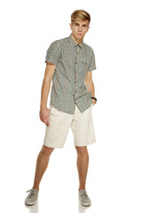 Young handsome male in shorts posing in full length