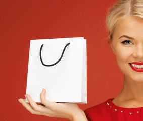 lovely woman in red dress with shopping bag