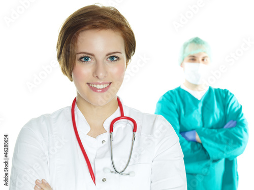 Female doctor in front of an operating surgeon