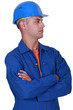 Laborer with arms crossed on white background
