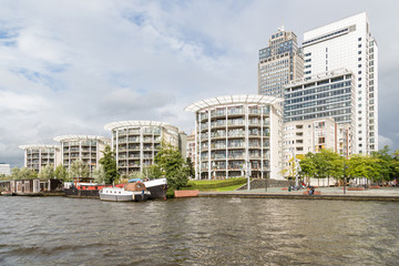 Amsterdam office buildings along the river Amstel in The Netherl
