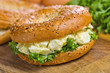 Toasted bagel with egg salad.
