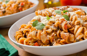 Rotini with tomato sauce and fresh oregano.
