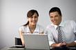 Business couple sat at desk