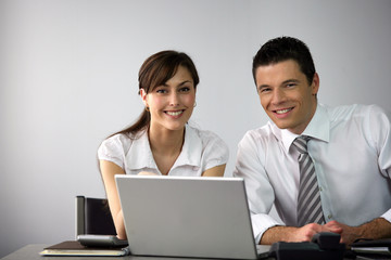 Business couple sat at desk