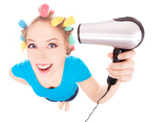 Funny girl styling hair, holding hairdryer
