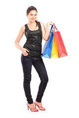 Full length portrait of a young female holding shopping bags