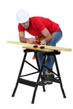 Man planning plank of wood