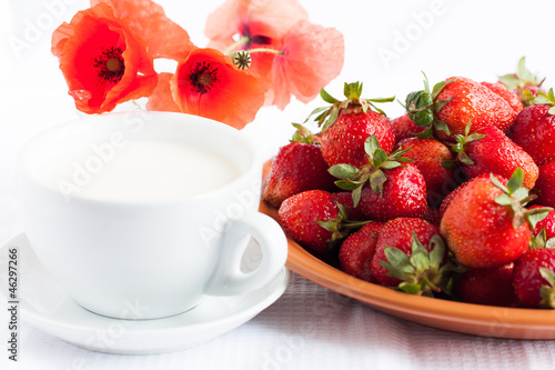 Cup of milk and juicy strawberries - a healthy breakfast