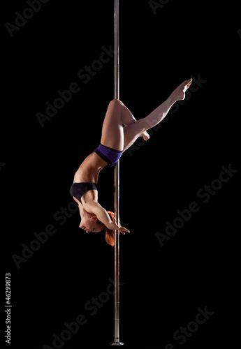 Woman show high gymnastic level during pole dance