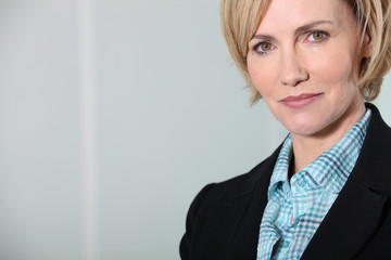 Headshot confident female executive