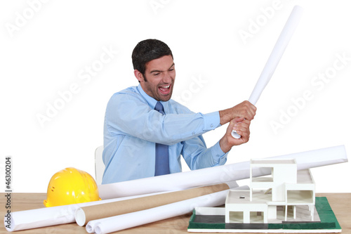 Man about to destroy a building model