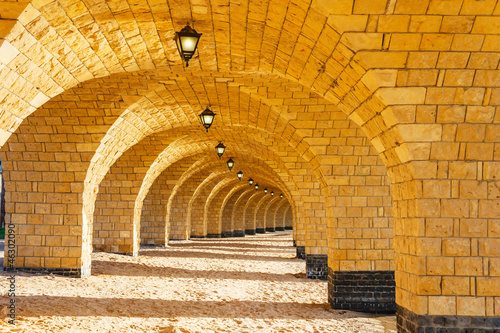 Wall mural The arched stone colonnade with lanterns