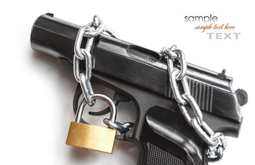 the gun, chain and closed padlock
