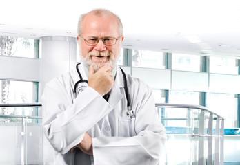 pensive senior medical doctor in clinic