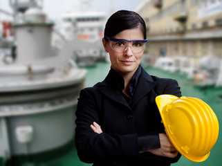 female naval engineer against  ship background