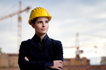 female engineer  over building yard background