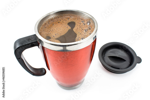Red thermos with coffee drink and lid