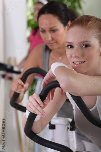 Woman using gym equipment