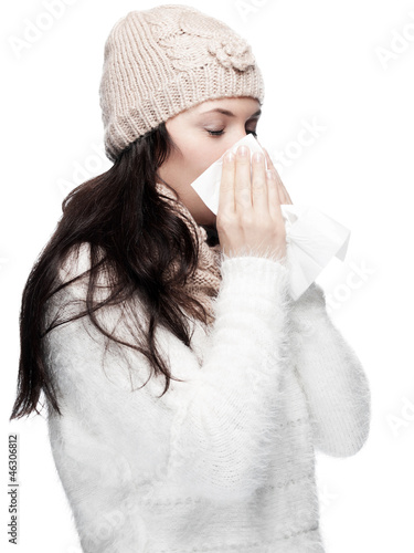 Young Lady in Winter clothes blows her nose