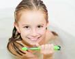 girl brushing teeth in bath